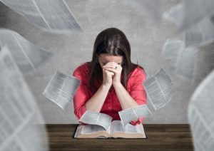 Woman pray and read